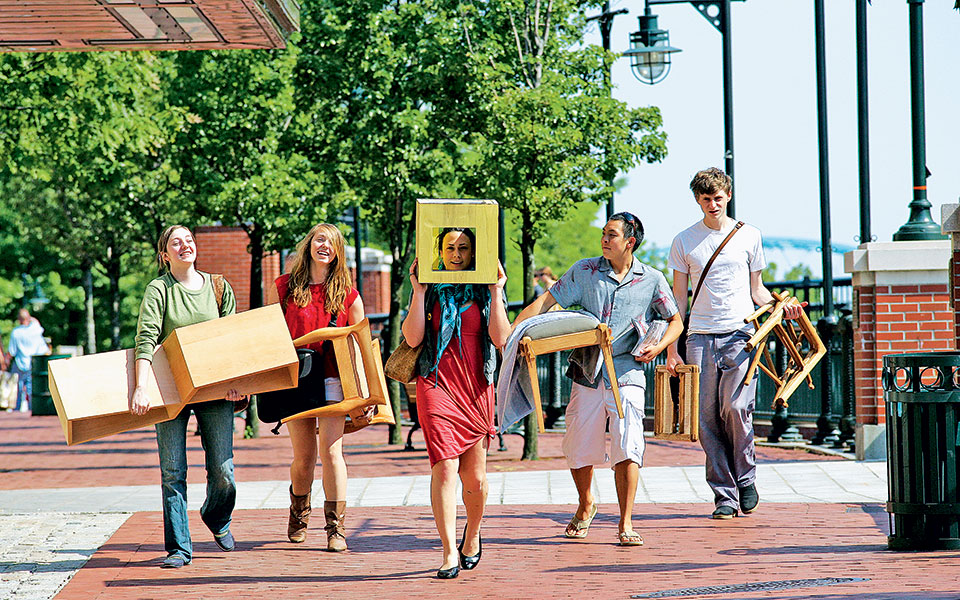 students-carrying-their-projects-to-studio