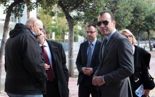 Οι βουλευτές της Χρυσής Αυγής, Παναγιώτης Ηλιόπουλος (Δ)   και Γιώργος Γερμενής (Α) συνομιλούν έξω από τον Άρειο Πάγο, την  Δευτέρα 25 Νοεμβρίου 2013.  Οι βουλευτές της Χρυσής Αυγής, Γιώργος Γερμενής , Παναγιώτης Ηλιόπουλος και Στάθης Μπούκουρας,  έχουν κληθεί να  καταθέσουν ενώπιον των εφετών ανακριτριών κατηγορούμενοι για το κακούργημα της διεύθυνσης και ένταξης σε εγκληματική οργάνωση, για το οποίο πριν λίγο καιρό η Βουλή αποφάσισε την άρση της ασυλίας τους.  . Οι βουλευτές αναμένεται να λάβουν αντίγραφα της δικογραφίας και να ζητήσουν προθεσμία προκειμένου να προετοιμάσουν την απολογία τους.  Ενώ  μέλη και υποστηριχτές του κόμματος πραγματοποιούν συγκέντρωση συμπαράστασης στους Βουλευτές. ΑΠΕ ΜΠΕ/ΑΠΕ ΜΠΕ/ΠΑΝΤΕΛΗΣ ΣΑΪΤΑΣ