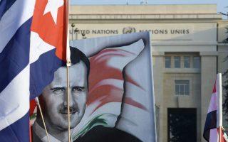 Πορτρέτο το Σύρου προέδρου Ασάντ με μια κουβανική σημαία σε διαδήλωση έξω από τα γραφεία του ΟΗΕ στη Γενεύη.