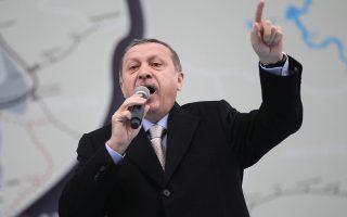 epa04064549 Turkish Prime Minister Recep Tayyip Erdogan speaks during a local election campaign in Istanbul, Turkey, 09 February 2014.  EPA/SEDAT SUNA