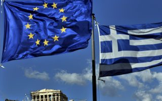 The European and the Greek flags fly above the ancient temple of Parthenon atop the Acropolis hill in Athens on May 10, 2011. Experts from the European Union, International Monetary Fund and European Central Bank (ECB) began on May 10 an audit of finances and reforms in Greece to determine if it merits a critical new slice of funding from a bailout package agreed last year.  AFP PHOTO / ARIS MESSINIS