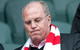 epa03670890 (FILES) A file photo from 6 November 2010 showing the President of German soccer club Bayern Munich Uli Hoeness reading a match programme during the Borussia Moenchengladbach-Bayern game.  Hoeness is under investigation for possible tax evasion after filing a complaint against himself about a Swiss bank account. He told a German magazine 20 April 2012 : 'through my tax consultant, i filed a complaint about me in January 2013 with the tax' authorities  EPA/BERND THISSEN