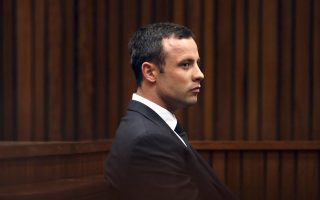 Oscar Pistorius, listens to cross questioning in court during his trial at the high court in Pretoria, South Africa, Friday, March 7, 2014. Pistorius is charged with murder for the shooting death of his girlfriend,  Steenkamp, on Valentines Day in 2013. (AP Photo/Themba Hadebe, Pool)