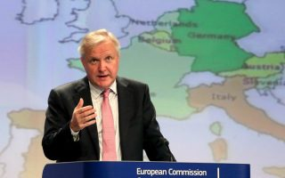 epa03950892 Olli Rehn the Vice-President of the European Commission in charge of Economic and Monetary Affairs during   the presentation of the autumn budgetary surveillance package during a news conference at the EU headquarters in Brussels, Belgium, 15 November 2013.  EPA/OLIVIER HOSLET