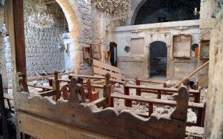 Φωτογραφία των ημερών από το εσωτερικό κατεστραμμένης χριστιανικής εκκλησίας στη Μααλούλα της Συρίας. Τα πάθη των χριστιανών της Μέσης Ανατολής υπενθυμίζει το τελευταίο τεύχος του αμερικανικού περιοδικού ΤΙΜΕ με ευρεία αναφορά στα όσα υποφέρουν οι κόπτες από φανατικούς ισλαμιστές στην Αίγυπτο.