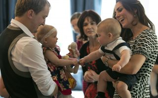 This handout photo taken on April 9, 2014 and provided by Woolf / Crown Copyright shows Catherine (R), the Duchess of Cambridge, holding her sone, Britain's Prince George, during a visit to the Plunket nurse and parents group at Government House in Wellington.  Plunket is a national not-for-profit organisation that provides care for children and families in New Zealand. Britain's Prince William, Kate and their son Prince George are on a three-week tour of New Zealand and Australia.      AFP PHOTO / Woolf Crown Copyright----EDITORS NOTE ----RESTRICTED TO EDITORIAL USE MANDATORY CREDIT