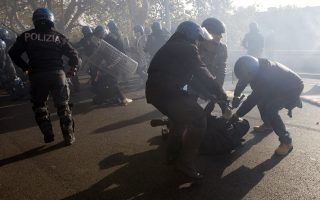 Riot police clash with students during a demonstration against austerity measures in downtown Rome. Police and protesters clashed in Spain and Italy on Wednesday as millions of workers went on strike across Europe to protest against spending cuts they say have made the economic crisis worse. (Reuters)