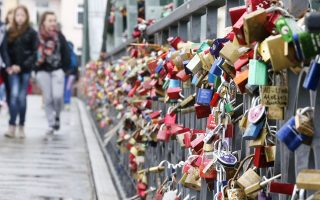 Padlocks are fixed by lovers at a pedestrian bridge over the river Main in Frankfurt, Germany, Monday, April 14, 2014. Lovers want to fix their love with the lock when they throw the key into the river. (AP Photo/Michael Probst)