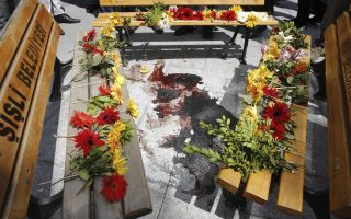 Flowers are laid at the place where Ugur Kurt was shot dead in Okmeydani cemevi, an Alevi place of worship, in Istanbul May 23, 2014. A bystander, Ugur Kurt, who was attending a relative's funeral, was shot in the head apparently by a stray bullet as the violence flared on Thursday. A second person died on Friday after clashes between Turkish police and protesters in a working-class district of Istanbul, stirring fears of further unrest as the anniversary of last year's anti-government demonstrations approaches. REUTERS/Murad Sezer (TURKEY - Tags: CIVIL UNREST POLITICS OBITUARY TPX IMAGES OF THE DAY)