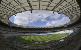 Colombia's team exercises during an official training session the day before the group C World Cup soccer match between Colombia and Greece at the Mineirao Stadium in Belo Horizonte, Brazil, Friday, June 13, 2014.  (AP Photo/Jon Super)