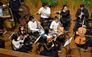Members of Paraguay's Cateura Orchestra of Recycled Instruments play at the end of the OAS 44th General Assembly inauguration, in Asuncion, Paraguay, on June 3, 2014.   AFP PHOTO / CRIS BOURONCLE