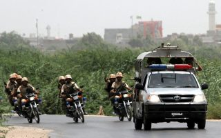epa04247563 Members of the Pakistani security forces secure the area after suspected militants attacked a building adjacent to Pakistan's largest airport in Karachi, Pakistan, 10 June 2014. Suspected militants on 10 June have attempted to storm a building adjacent to Pakistan's largest airport, the same facility where Taliban fighters killed 28 civilians and security officials in a night-long gun battle this weekend, according to media reports. Authorities suspended all flights and closed roads leading to Karachi's Jinnah International Airport after gunmen fired shots at guards at the entrance of a residential colony for airport security forces, Dunya television reported.  EPA/REHAN KHAN