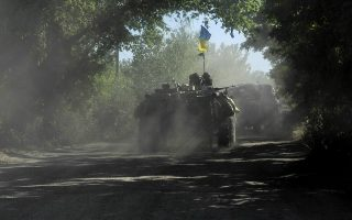 A hand out picture taken on June 3, 2014 and released by the Prime Minister Press Service displays an  APC of the Ukrainian forces moving some 20 km from the eastern Ukrainian city of Slavyansk. Ukraine shook up its beleaguered army's top brass on June 3, 2014 as clashes raged in the separatist east despite mounting US and German pressure on Russia to force the rebels to halt fire. AFP PHOTO/ PRIME-MINISTER PRESS SERVICE/ ANDREW KRAVCHENKO  RESTRICTED TO EDITORIAL USE - MANDATORY CREDIT