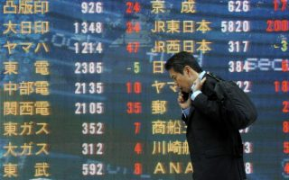epa01835714 Japanese businessman talks on his phone in front of a Nikkei stock index board in downtown Tokyo, Japan, 24 August, 2009. Tokyo stocks start the week up 342.85 points, 3.35 percent to close the day at 10581.05. The rise was due to strong Wall Street trading on friday and strength from other Asian markets.  EPA/EVERETT KENNEDY BROWN