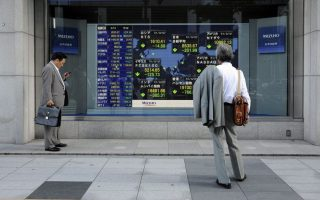 epa02912719 Businessmen stand in front of a stock market indicator board in Tokyo, Japan, 12 September 2011. Japanese stocks plunged 2.3 per cent to their lowest point in more than two years on 12 September after heavy losses on Wall Street and European markets as concerns grew over the Greek debt crisis. The benchmark Nikkei 225 Stock Average lost 201.99 points, or 2.31 per cent, to 8,535.67, the lowest since April 2009.  EPA/FRANCK ROBICHON