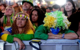 epaselect epa04313124 Brazilian soccer fans at the FIFA Fanfest  watch the match for third place between Brazil and Netherlands, at the Copacabana beach in Rio de Janeiro, Brazil, 12 July 2014. The Netherlands clinched third place in the 2014 World Cup with a 3-0 crushing of Brazil.  EPA/DIEGO AZUBEL