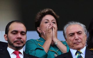 epa04252860 Brazilian President Dilma Rousseff (C) reacts during the FIFA World Cup 2014 group A preliminary round match between Brazil and Croatia at the Arena Corinthians in Sao Paulo, Brazil, 12 June 2014.   (RESTRICTIONS APPLY: Editorial Use Only, not used in association with any commercial entity - Images must not be used in any form of alert service or push service of any kind including via mobile alert services, downloads to mobile devices or MMS messaging - Images must appear as still images and must not emulate match action video footage - No alteration is made to, and no text or image is superimposed over, any published image which: (a) intentionally obscures or removes a sponsor identification image; or (b) adds or overlays the commercial identification of any third party which is not officially associated with the FIFA World Cup)  EPA/SEBASTIAO MOREIRA   EDITORIAL USE ONLY