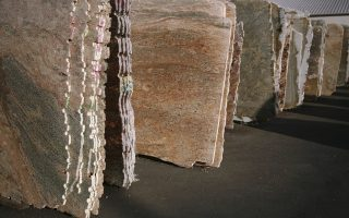 A row of Granite slabs at a sales and distribution center.