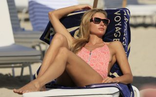 Jessica Hart seen relaxing on the beach for a fashion editorial shoot in South Beach, Florida.