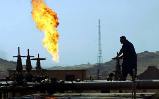 06 Aug 2003, Kirkuk, Iraq --- A worker maintains production at the North Oil Company in Kirkuk. North Oil Company, which produces two-thirds of Iraq's total, has been unable to export due to sabotage on the pipeline, twice last month. --- Image by © Ed Kashi/Corbis