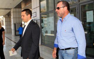 Οι βουλευτές της Χρυσής Αυγής Ηλίας Κασιδιάρης και Νίκος Μίχος  εξέρχονται από το Εφετείο Αθηνών