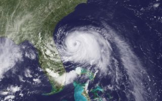UNITED STATES - JULY 2: In this handout provided by the National Oceanic and Atmospheric Administration (NOAA) from the GOES-East satellite, Tropical Storm Arthur travels up the east coast of the United States in the Atlantic Ocean pictured at 19:45 UTC/GMT on July 2, 2014. According to reports, Arthur, now with maximum sustaned winds of 70 mph, has begun moving steadily northward is expected to strike the North Carolina Outer Banks over the Fourth of July holiday. Arthur is expected to become a hurricane by July 3.   (Photo by NOAA via Getty Images)