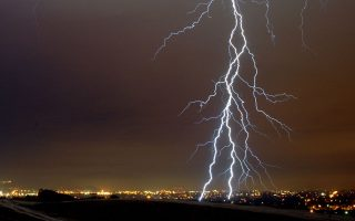 Lightning from a fast-moving thunderstorm moves through the San Fernando Valley area of Los Angeles during the early morning Wednesday Dec. 27,2006. A strong cold front was expected to move through the region Wednesday, bringing rain, snow in the mountains and strong and gusty winds, forecasters said. (AP Photo/Mike Meadows)