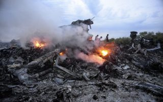 epa04320262 Debris of the Boeing 777, Malaysia Arilines flight MH17, which crashed during flying over the eastern Ukraine region near Donetsk, Ukraine, 17 July 2014.  A Malaysia Airlines plane with 295 people on board crashed in eastern Ukraine, and both the government and separatist rebels fighting in the area denied shooting it down. All passengers on board Flight MH17 from Amsterdam to Kuala Lumpur are feared dead. Malaysia Airlines said that it lost contact with Flight MH17 at 1415 GMT, about 50 kilometres from the Russia-Ukraine border. The plane was carrying 280 passengers and 15 crew members, the airline said.  EPA/ALYONA ZYKINA  EPA/ALYONA ZYKINA