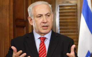 Israeli Prime Minister Benjamin Netanyahu speaks after a meeting with Canadian Prime Minister Stephen Harper in Ottawa, Canada, Monday May 31, 2010. (AP Photo/The Canadian Press, Adrian Wyld)