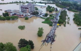 This image made available by the Serbian police shows the flooded area in Obrenovac, some 30 kilometers (18 miles) southwest of Belgrade, Serbia, Sunday, May 18, 2014. In Serbia, more than 20,000 people have been forced from their homes. Officials there fear more flooding later Sunday as floodwaters travel down the Sava and reach the country. Serbian officials said that the flood wave might be lower than initially expected, because the river broke barriers upstream in Croatia and Bosnia. Experts said they expect Sava floodwaters to rise for two more days, then subside. (AP Photo/Serbian Police) ORG XMIT: XDMV132