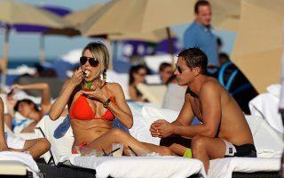 Rita Rusic eating lunch on the beach in Miami