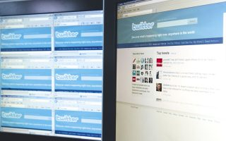Website pages from Twitter.com are displayed on computer monitors in London, U.K., on Friday, April 9, 2010. Twitter Inc. said it agreed to buy Atebits, maker of a Twitter application for Apple Inc.'s iPhone. Photographer: Chris Ratcliffe/Bloomberg