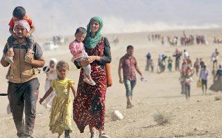 Πλήθη προσφύγων της μειονότητας των Γιαζιντί εγκαταλείπουν την ιρακινή Σιντζάρ, για να καταφύγουν εντός του συριακού εδάφους.