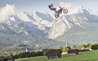 epa04318217 Luc Ackerman of Germany performs in front of the Zugspitze, the highest mountain in Germany, prior to the upcoming fourth stage of the Red Bull X-Fighters World Tour in Munich, Germany on July 16, 2014.  EPA/Sebastian Marko / GLOBAL NEWSROOM / HO  HANDOUT EDITORIAL USE ONLY/NO SALES