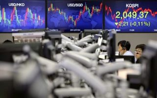 Currency traders work near a screen showing the Korea Composite Stock Price Index (KOSPI), right, at the foreign exchange dealing room of the Korea Exchange Bank headquarters in Seoul, South Korea, Wednesday, Sept. 3, 2014. Asian stock markets rose Wednesday, lifted by new signs of strength in the U.S. economy and expectations that Europe's central bank will provide more support to the flagging region. (AP Photo/Lee Jin-man)