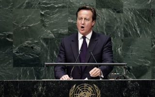 epa04416102 British Prime Minister, David Cameron speaks during the general debate of the 69th session of the United Nations General Assembly at United Nations headquarters in New York, New York, USA, 24 September 2014.  EPA/JASON SZENES