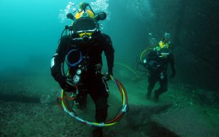 110629-N-XD935-058VALPARAISO, Chile (June 29, 2011) Petty Officer 2nd Class Roprigo Fuentas, right, and 2nd Sgt. Bernardo Alcaide, navy divers assigned to the Chilean Buzo Salvatoaja, walk along the ocean floor during diving operations. Mobile Diving and Salvage Unit (MDSU) 2, Company 2-3, is participating in Navy Diver-Southern Partnership Station is a multinational partnership engagement intended to increase interoperability and partner nation capacity through diving operations. (U.S. Navy photo by Mass Communication Specialist 1st Class Jayme Pastoric/Released)