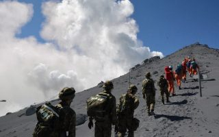 epa04421861 A handout picture released on 28 September 2014 by Japan's Defense Ministry Joint Staff shows Japanese Self-Defense Force members and firefighters during a rescue operation on Mount Ontake, between Gifu and Nagano prefectures, in central Japan, 28 September 2014. More than 30 people were in critical condition near the peak of a volcano in central Japan on 28 September after its eruption the previous day, local media reported. Mount Ontake is one of the most popular destinations among trekkers, its last major eruption in 1979 when it spewed more than 200,000 tons of ash.  EPA/JAPANESE DEFENSE MINISTRY JOINT STAFF / HANDOUT  HANDOUT EDITORIAL USE ONLY/NO SALES
