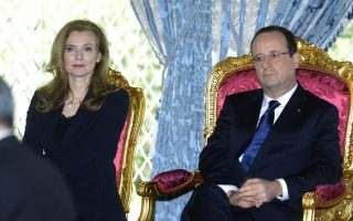 CASABLANCA, MOROCCO - APRIL 03: French President Francois Hollande (L) arrives at Casablanca on April 3, 2013 in Casablanca, Morocco.  ?French President's companion Valerie Trierweiler during the French President two-day visit in Casablanca on April 3, 2013?