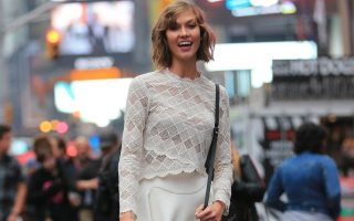 Karlie Kloss does a photoshoot in Times Square and rides a pedicab in NYC