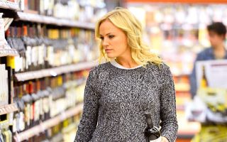 EXCLUSIVE: Malin Akerman picks up a bottle of wine at Gelson's Supermarket in Los Angeles, CA