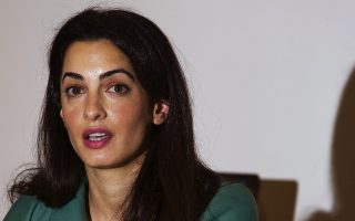 Lawyer Amal Alamuddin is pictured during a press conference in London on November 5, 2012. The British law firm that employs George Clooney's girlfriend Amal Alamuddin confirmed on Monday April 28, 2014, that the couple were engaged and offered its congratulations. AFP PHOTO/JUSTIN TALLISJUSTIN TALLIS/AFP/Getty Images