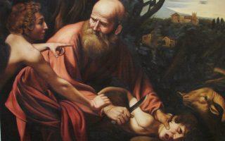 Ο Καραβάτζιο εικονογραφεί τη στιγμή που άγγελος Κυρίου εμποδίζει τον Αβραάμ να θυσιάσει τον Ισαάκ.
