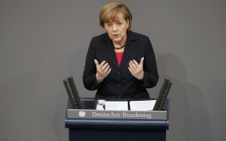 German Chancellor Angela Merkel addresses the Bundestag, the lower house of parliament, at the start of a debate on the 2014 budget at the Reichstag in Berlin April 9, 2014.     (GERMANY) REUTERS/Fabrizio Bensch (GERMANY  - Tags: POLITICS)