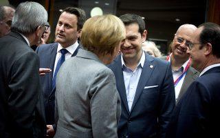 Ο κ. Τσίπρας με την κα. Μέρκελ στο περιθώριο της Συνόδου Κορυφής.
