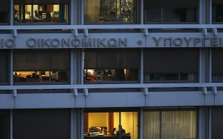 A view is seen of the Greek Ministry of Finance in central Athens February 25, 2015.  A prominent Greek minister defied his government's pledge to press on with some state asset sales, revealing the first open dissent within Prime Minister Alexis Tsipras's coalition and highlighting the tightrope that the leftist premier must walk. The sign reads