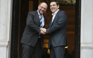 Greek Prime Minister Alexis Tsipras (R) and European Parliament President Martin Schulz shake hands outside the Greek Premier's office in Athens January 29, 2015. Schulz warned leftist Tsipras on Wednesday against diverging from the European Union's stance towards Russia in the Ukraine crisis. Schulz, a member of Germany's co-governing Social Democrats, met Tsipras on Thursday in Athens to discuss the agenda of his new anti-bailout government and how Greece wants to solve its debt problems.   REUTERS/Marko Djurica  (GREECE - Tags: POLITICS BUSINESS)
