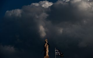 TOPSHOTSA Greek flag waves next to a statue of the ancient Greek goddess Athena in the center of Athens on March 12, 2015. Greece announced on March 12 it was officially launching a partnership deal with the OECD to draw up economic reforms, which Prime Minister Alexis Tsipras said would help rebuild trust with international creditors.                            AFP PHOTO / ARIS MESSINIS