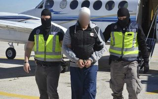 A suspected Islamist militant (C) is led by Spanish National Police officers after being arrested in the Spanish North African city of Ceuta, March 10, 2015. Spain said on Tuesday it has dismantled a militant Islamic cell in its North African enclave of Ceuta that it claims was ready to attack either Spain or other targets in Europe. Police arrested two suspected militants as part of a wider security operation that began in January, the Interior Ministry said. The two male suspects in Ceuta, on the Moroccan coast, included a Spanish and Moroccan national and were arrested as part of the same police investigation that led to the arrest of four people in January, the ministry said. Picture is blurred at source. REUTERS/Spanish Interior Ministry/Handout via Reuters (SPAIN - Tags: POLITICS CIVIL UNREST CRIME LAW) ATTENTION EDITORS - THIS PICTURE WAS PROVIDED BY A THIRD PARTY. REUTERS IS UNABLE TO INDEPENDENTLY VERIFY THE AUTHENTICITY, CONTENT, LOCATION OR DATE OF THIS IMAGE. NO SALES. NO ARCHIVES. FOR EDITORIAL USE ONLY. NOT FOR SALE FOR MARKETING OR ADVERTISING CAMPAIGNS. THIS PICTURE IS DISTRIBUTED EXACTLY AS RECEIVED BY REUTERS, AS A SERVICE TO CLIENTS