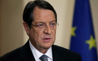 Cyprus' President Nicos Anastasiades addresses the nation with a televised speech from the presidential palace in Nicosia March 25, 2013. Cyprus reached a last-ditch deal with international lenders on a 10 billion euro rescue plan to avoid economic meltdown, agreeing to close down its second-largest bank and inflict heavy losses on big depositors.    REUTERS/Petros Karadjias/Pool  (CYPRUS - Tags: BUSINESS POLITICS PROFILE)